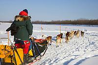 Jacques Philips team mushes out of McGrath Chkpt onto Kuskokwim River 2006 Iditarod Interior AK Winter