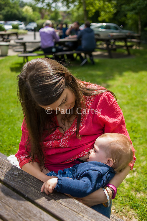 "Image from the breastfeeding collection of the ""We Do It In Public"" documentary photography picture library project: <br />  www.breastfeedinginpublic.co.uk<br /> <br /> <br /> Hampshire, England, UK<br /> 19/06/2013<br /> <br /> © Paul Carter / wdiip.co.uk"