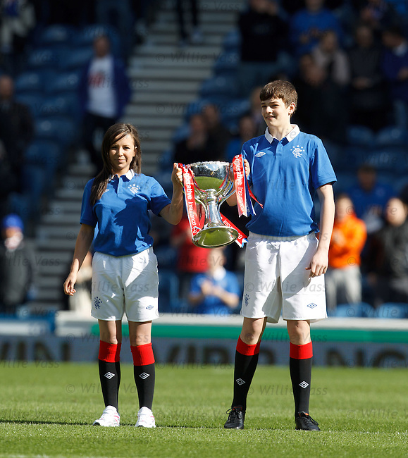 The Scottish League Cup paraded at Ibrox by two young mascots