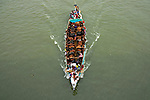 """Pictured: Dozens of cattle are crammed into narrow boats with tens of people on as they are taken to market.   More than 50 of the animals can be seen standing on the boats as they crossed a river.<br /> <br /> Photographer Azim Khan Ronnie said the cattle were crossing Buriganga River in Dhaka, Bangladesh, to be sold in the city.   Mr Ronnie, 33, from Dhaka, said: """"The livestock are brought very long distances on the boat, some from 300km away.   SEE OUR COPY FOR DETAILS<br /> <br /> Please byline: Azim Khan Ronnie/Solent News<br /> <br /> © Azim Khan Ronnie/Solent News & Photo Agency<br /> UK +44 (0) 2380 458800"""