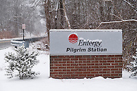A sign for Pilgrim Station stands near the Entergy-run nuclear power plant in Plymouth, Massachusetts, USA, on Tues., Jan. 31, 2017.