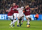 4th February 2019, London Stadium, London, England; EPL Premier League football, West Ham United versus Liverpool; Sadio Mane of Liverpool being challenged by Ryan Fredericks, Angelo Ogbonna and Declan Rice of West Ham United in the box