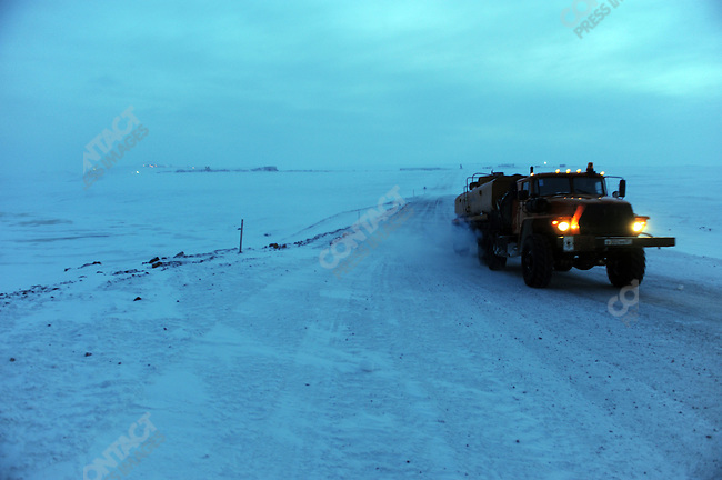 At the Kupol gold mine in Chukotka operated by the Canadian company Kinross, a tanker left the mine before heading back to the winter road to the port of Pevek. Russian Far East, February 8, 2011