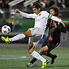 New York Cosmos captain No. 4 Carlos Mendes, left, kicks a ball away from Ottawa Fury No. 9 Tom Heinemann during the first half of the NASL Championship at Shuart Stadium, located on the campus of Hofstra University, on Sunday, Nov. 15, 2015. The Cosmos won the match by a score of 3-2.<br /> James Escher