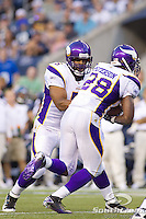 Minnesota Vikings quarterback Donovan McNabb (5) hands the ball to running back Adrian Peterson (28) in a game against the Seattle Seahawks at CenturyLink Field in Seattle, Washington. The Minnesota Vikings won the game, 20-7.