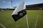 Edinburgh City v Spartans, 11/04/2015. Commonwealth Stadium, Scottish Lowland League. A corner flag with club logo at the Commonwealth Stadium at Meadowbank before the Scottish Lowland League match between Edinburgh City and city rivals Spartans, which was won by the hosts by 2-0. Edinburgh City were the 2014-15 league champions and progressed to a play-off to decide whether there would be a club promoted to the Scottish League for the first time in its history. The Commonwealth Stadium hosted Scottish League matches between 1974-95 when Meadowbank Thistle played there. Photo by Colin McPherson.