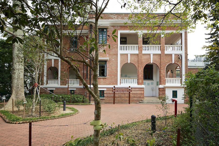 Woodside, after restoration in 2012, but still with some trees in the way. Provided residences for two senior managers at the sugar plant or dockyard. Completed in 1917, now merged into one unit and housing an education centre, the building is open to the public.