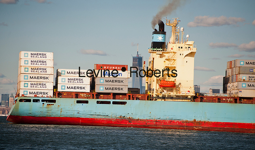 The Maersk line Sea Land Champion laden with containers leaves port in the New York and New Jersey harbor on Sunday, September 23, 2012.  The under construction World Trade Center is seen in the skyline.(© Richard B. Levine)