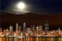 Seattle skyline and full moon reflecting in Elliot Bay viewed from West Seattle, Seattle, Washington, US