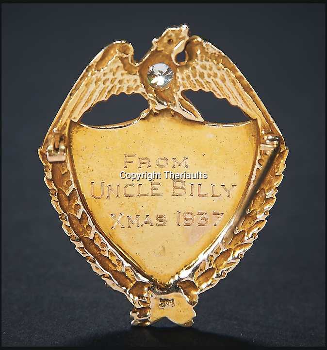BNPS.co.uk (01202 558833)<br /> Pic: Theriaults/BNPS<br /> <br /> Shirley Temple's diamond-studded police badge, a gift from 'Bojangles'.<br /> <br /> The costumes worn by childhood movie star Shirley Temple during her Hollywood career make up a long-lost &pound;1.5m collection belonging to the late actress.<br /> <br /> The curly-haired performer's parents made it a condition that she got to keep all of her outfits after filming rather than return them to the movie studios.<br /> <br /> The child costumes, that include the iconic red and white polka-dot dress the then six year old wore in her breakthrough role in the 1934 flick 'Stand Up and Cheer', have been locked away in a vault at her home for 75 years. They are being sold in Maryland, US.