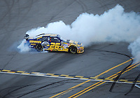 Nov. 1, 2009; Talladega, AL, USA; NASCAR Sprint Cup Series driver Jamie McMurray (26) celebrates after winning the Amp Energy 500 at the Talladega Superspeedway. Mandatory Credit: Mark J. Rebilas-