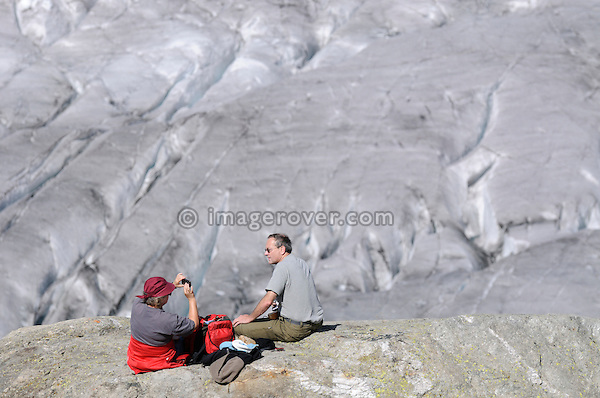 Switzerland, Valais, Western Europe, Jungfrau Region, Aletsch Glacier (UNESCO world heritage site). Hikers resting nr. the Märjelensee. Note: No releases available.