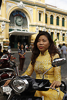 Model release - woman in Ao Dai : the traditional vietnamese dress, pose in Ho Chi Minh City - District One