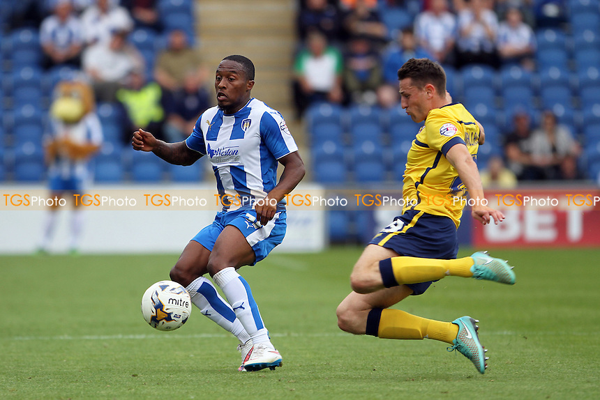 Murray Wallace of Scunthorpe United challenges Callum Harriott of Colchester United during Colchester United vs Scunthorpe United, Sky Bet League 1 Football at the Weston Homes Community Stadium, Colchester, England on 29/08/2015