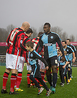 Aaron Pierre of Wycombe Wanderers shakes hands with Kevin Ellison of Morecambe during the Sky Bet League 2 match between Wycombe Wanderers and Morecambe at Adams Park, High Wycombe, England on 2 January 2016. Photo by Andy Rowland / PRiME Media Images