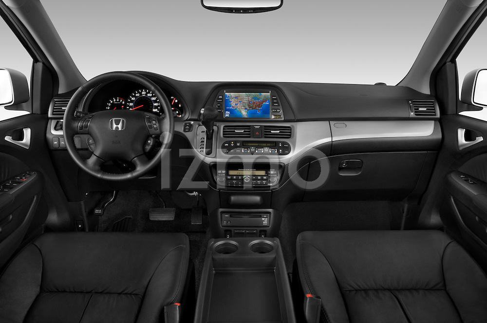 Straight dashboard view of a 2009 Honda Odyssey Touring.