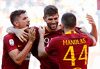 Roma's Federico Fazio, celebrates with teammates Lorenzo Pellegrini, left, and Kostas Manolas after scoring during the Italian Serie A football match between Roma and Lazio at Rome's Olympic stadium, September 29, 2018. Roma won 3-1.<br /> UPDATE IMAGES PRESS/Riccardo De Luca