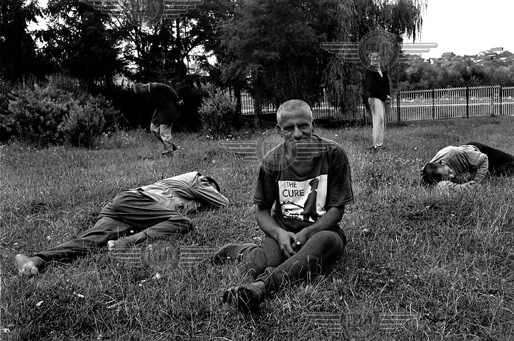 Patients in the garden of the Pristina mental hospital during the NATO bombing campaign of Kosovo in May 1999........... One man wears a T-shirt for the band The Cure.