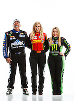 Feb 8, 2017; Pomona, CA, USA; NHRA funny car driver John Force (left), daughter Courtney Force (center) and top fuel driver Brittany Force pose for a portrait during media day at Auto Club Raceway at Pomona. Mandatory Credit: Mark J. Rebilas-USA TODAY Sports