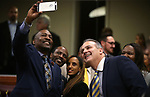 Nevada Assemblyman Tyrone Thompson, D-North Las Vegas, left, takes selfies with fellow lawmakers and friends before the start of Gov. Steve Sisolak's State of the State address in Carson City, Nev., on Wednesday, Jan. 16, 2019. (Cathleen Allison/Las Vegas Review-Journal)