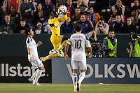 New York Red Bull goal keep Bouna Coundoul (18) leaps high for save between advancing LA Galaxy players Juan Panlo Angel and Landon Donovan. The LA Galaxy and Red Bulls of New York played to a 1-1 tie at Home Depot Center stadium in Carson, California on  May 7, 2011....