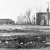 Detroit, Michigan<br /> USA<br /> March 25, 2009<br /> <br /> Known as the world's automotive center Detroit was once the home of 1.85 million people in the 1950's. It now houses 917,000 and for this reason it is said that there are now 80,000 abandoned buildings within the city.  <br /> <br /> A street near the city center with nothing but closed businesses and factories in the shadow of the GM Corporate Headquarters, home of the company that had a government $13.4 billion bailout in December of 2008.