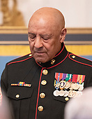 Sergeant Major John L. Canley, United States Marine Corps (Retired) bows his head in prayer during the ceremony where US President Donald J. Trump awarded him the Medal of Honor for conspicuous gallantry during the Vietnam War in a ceremony in the East Room of the the White House in Washington, DC on Wednesday, October 17, 2018.<br /> Credit: Ron Sachs / CNP