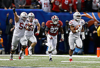 Ohio State Buckeyes running back Ezekiel Elliott (15) breaks away for long touchdown run in the fourth quarter of the Allstate Sugar Bowl and College Football Playoff Semifinal at Mercedes-Benz Superdome in New Orleans, Friday night, January 2, 2015. The Ohio State Buckeyes defeated the Alabama Crimson Tide 42 - 35. (The Columbus Dispatch / Eamon Queeney)