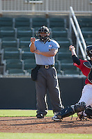 Home plate umpire Cody Clark makes a strike call during the South Atlantic League game between the Hickory Crawdads and the Kannapolis Intimidators at CMC-Northeast Stadium on May 21, 2015 in Kannapolis, North Carolina.  The Intimidators defeated the Crawdads 2-0 in game one of a double-header.  (Brian Westerholt/Four Seam Images)