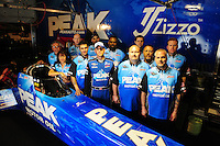 Mar. 10, 2012; Gainesville, FL, USA; NHRA top fuel dragster driver T.J. Zizzo poses for a group photo with his crew during qualifying for the Gatornationals at Auto Plus Raceway at Gainesville. Mandatory Credit: Mark J. Rebilas-