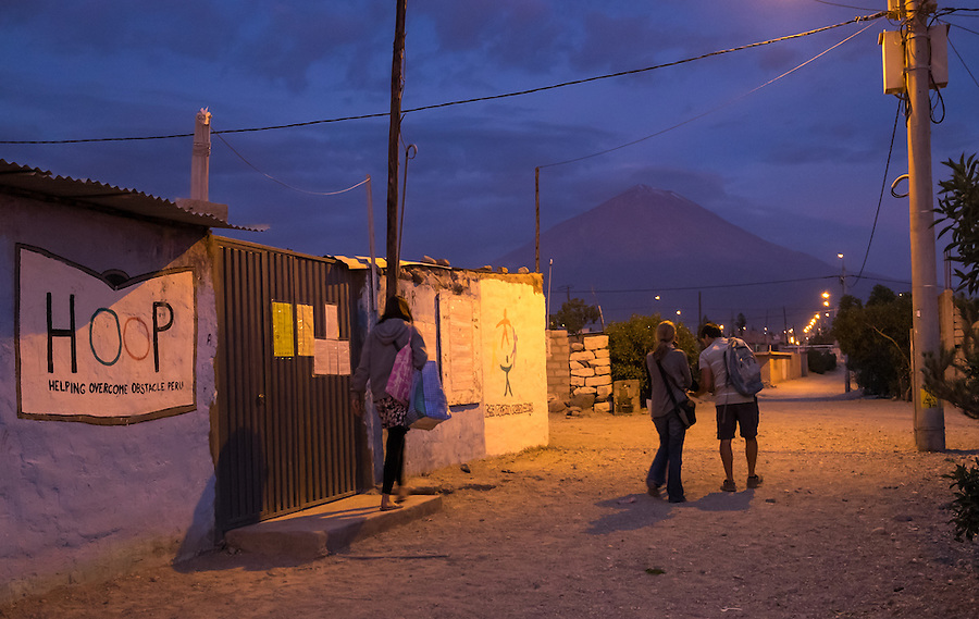 AREQUIPA, PERU - APRIL 7, 2014: Volunteers walking out after a day of teaching in the community of Flora Tristan for HOOP Peru. HOOP Peru is a NGO fully committed to breaking the cycle of poverty by empowering the Flora Tristan families through enhancing their education.