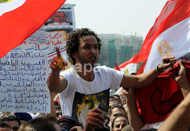 Egyptian demonstrators chant slogans during a protest at Tahrir Square in Cairo, Egypt, Friday, Sept. 30, 2011. Several thousand Egyptians are protesting against the country's military ruler's decision to retain the much hated emergency laws used throughout the reign of ousted President Hosni Mubarak to give police almost unquestionable powers to operate. Photo by Ahmed Asad