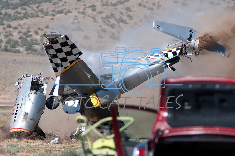 George Giboney crashes his Thunder Mustang, the Rapid Travel, during the super sport gold medal race at the 47th Annual National Championship Air Races and Air Show in Stead, Nev., on Sunday Sept. 19, 2010..Photo by Kevin Clifford