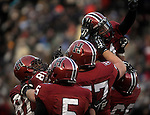 (Cambridge Ma 11/22/14) Harvard teammates celebrate with 1, Andrew Fischer, after scoring the winning touch down, as Harvard defeated Yale 31-24. Jim Michaud Photo