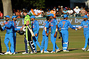 Cricketers shake hands at the end of play at the T20 match between Ireland and India at the Malahide cricket club in Dublin on June 27, 2018. Photo/Paul McErlane