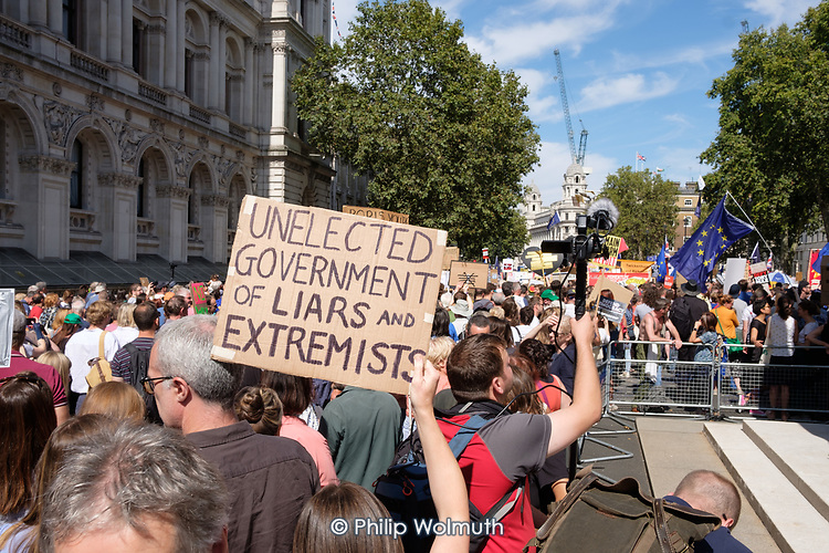 Protesters gather in Whitehall outside Downing Street to protest against the prorogation of Parliament by Prime Minister Boris Johnson, London, UK.