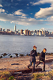 USA, New York,  Women in the East River State Park in Brooklyn with the New York City skyline in the distance