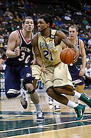 February 03, 2011:   Jacksonville Dolphins forward Delwan Graham (21) drives past Belmont Bruins forward Trevor Noack (30) during Atlantic Sun Conference action between the Jacksonville Dolphins and the Belmont Bruins at Veterans Memorial Arena in Jacksonville, Florida.  Belmont defeated Jacksonville 76-70.