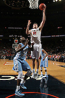 Virginia forward/center Mike Tobey (10) shoots over North Carolina forward Joel James (42) during an NCAA basketball game against Virginia Monday Jan. 20, 2014 in Charlottesville, VA. Virginia defeated North Carolina 76-61.