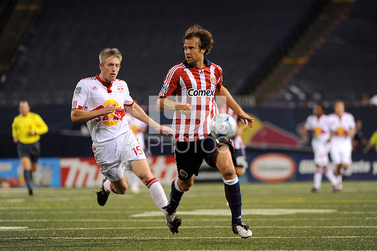 John Wolyniec (15) of the New York Red Bulls chases Carey Talley (12) of Chivas USA. Chivas USA defeated the New York Red Bulls 2-0 during a Major League Soccer match at Giants Stadium in East Rutherford, NJ, on August 15, 2009.