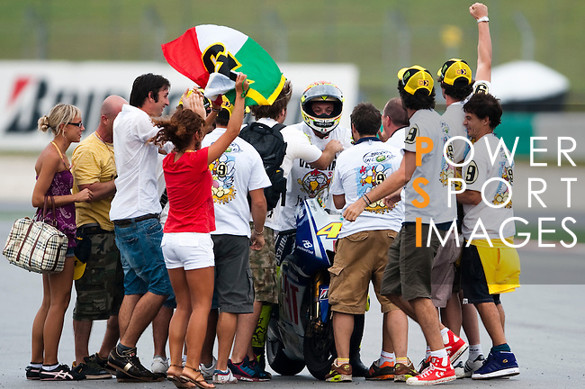 KUALA LUMPUR, MALAYSIA - OCTOBER 25:  Fiat Yamaha Team rider Valentino Rossi of Italy is surrounded by fans after winning his ninth MotoGP World Championship title with his third place in the Malaysian MotoGP, which is round 16 of the MotoGP World Championship at the Sepang Circuit on October 25, 2009 in Kuala Lumpur, Malaysia. Photo by Victor Fraile / The Power of Sport Images