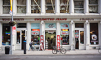 Unlimited Jeans is among other stores and restaurants in the West 23rd Street shopping corridor in the New York neighborhood of Chelsea on Saturday, September 20, 2014.  (© Richard B. Levine)