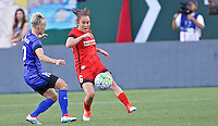 Portland, OR - Saturday July 30, 2016: Meleana Shim, Jessica Fishlock during a regular season National Women's Soccer League (NWSL) match between the Portland Thorns FC and Seattle Reign FC at Providence Park.