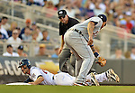 29 September 2012: Minnesota Twins third baseman  Trevor Plouffe slides safely into third during a game against the Detroit Tigers at Target Field in Minneapolis, MN. The Tigers defeated the Twins 6-4 in the second game of their 3-game series. Mandatory Credit: Ed Wolfstein Photo