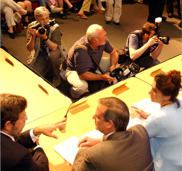 Newsday Photographer, jim Peppler (at top left wearing photo vest) taking photos at special meeting of the Roslyn School District School Board at the Roslyn High School Auditorium on Thursday June 10, 2004. (Photo by Joel Cairo).