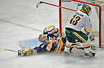 16 February 2008: Merrimack College Warriors' goaltender Andrew Braithwaite, a Sophomore from Kingston, Ontario, slides across the goalmouth to make a save on forward Corey Carlson, a Junior from Two Harbors, MN, of the University of Vermont Catamounts at Gutterson Fieldhouse in Burlington, Vermont. The Catamounts defeated the Warriors 2-1 for their second win of the 2-game weekend series...Mandatory Photo Credit: Ed Wolfstein Photo