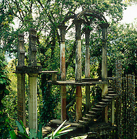 Edward James constructed a series of skeletal structures in his pleasure garden, strange ruins filled with symbolism