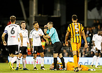 Referee, Tony Harrington indicates play was stopped due to a head injury during the Sky Bet Championship match between Fulham and Hull City at Craven Cottage, London, England on 13 September 2017. Photo by Carlton Myrie.