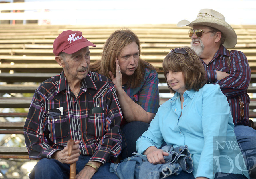 NWA Democrat-Gazette/BEN GOFF @NWABENGOFF<br /> Frank Fitch (from left) sits with his daughter-in-law Betty Fitch, son Nevada Fitch (Betty's husnand), and daughter Latonda Linker, all of Hindsville, Friday, June 23, 2017, during the third night of the 73rd annual Rodeo of the Ozarks at Parsons Stadium in Springdale. Frank Fitch has attended the Rodeo of the Ozarks each of the 73 years it's been held.