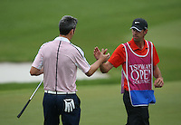 Ross Fisher (ENG) shakes hands with caddie Chris Fletcher Harmston after carding  67 (-18) and the outright lead after Round Three of The Tshwane Open 2014 at the Els (Copperleaf) Golf Club, City of Tshwane, Pretoria, South Africa. Picture:  David Lloyd / www.golffile.ie